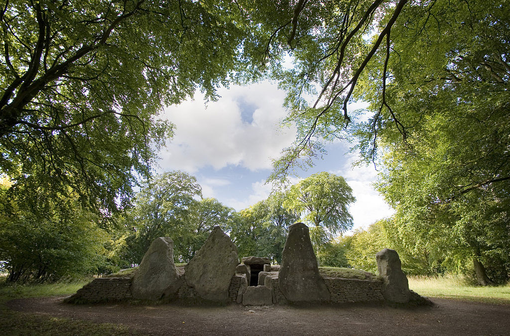 """Wayland Smithy Long barrow"" by Msemmettis licensed under CC BY-SA 3.0."